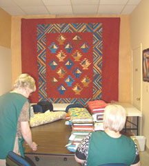Classroom Back Wall and 2 Happy JQI Workers & LeAnn's Basket Quilt